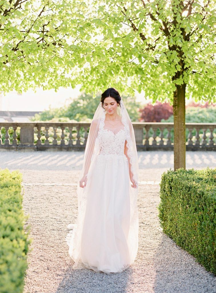 bride with veil getting married in germany wedding venue germany wedding castle germany velvet themed wedding dusty blue color palette