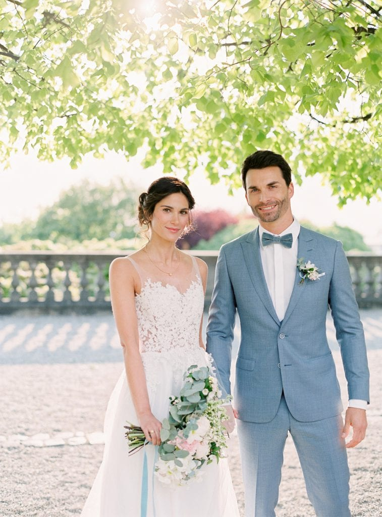 couple getting married in germany wedding venue castle in germany, velvet themed wedding velvet bow dusty blue color palette