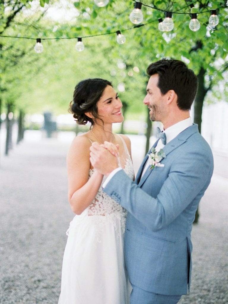 couple getting married in a german wedding castle with dusty blue color palette velvet themed wedding wedding venue germany