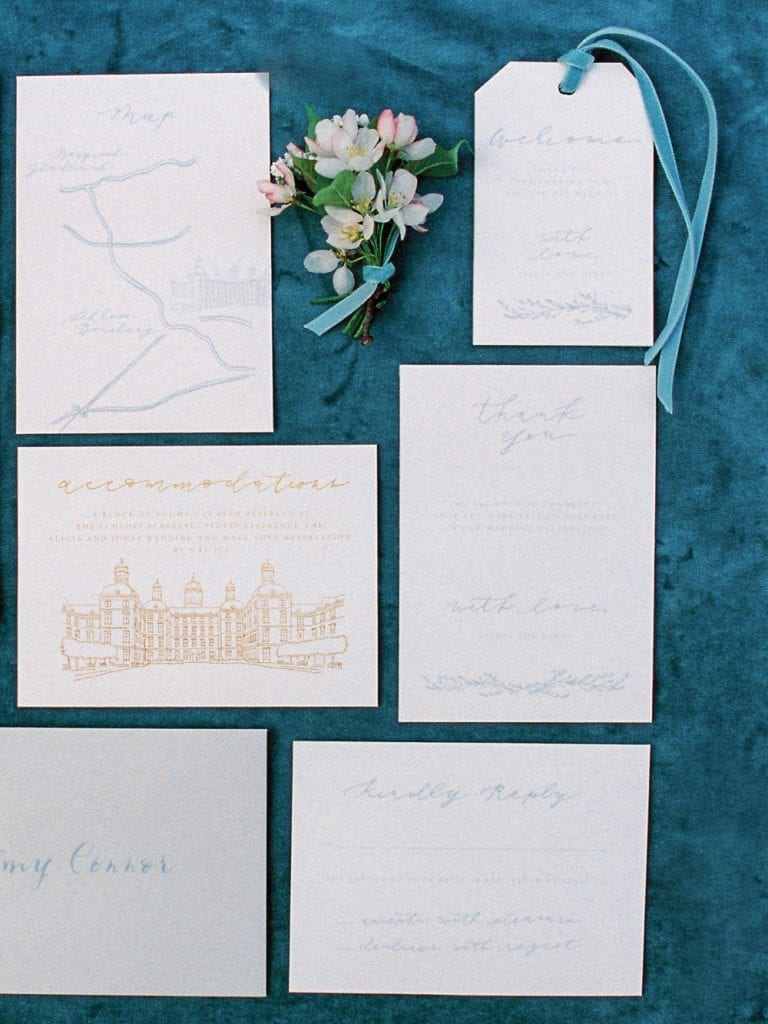 stationary in dusty blue color palette for a velvet themed wedding in a wedding castle in germany wedding venue germany getting married in germany