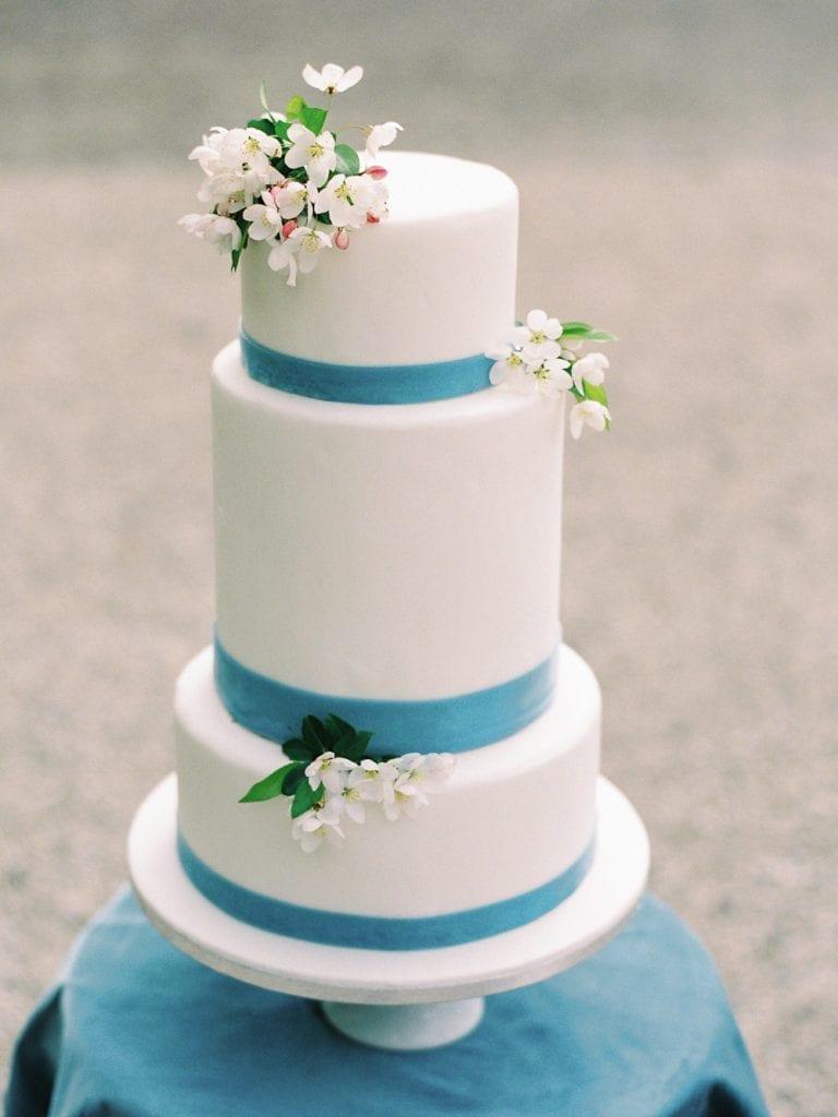 castle wedding in germany white wedding cake with dusty blue color palette velvet themed wedding getting married in germany wedding venue germany