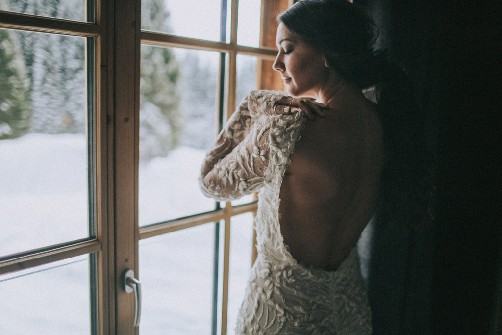 bride getting ready, elopement, winter wedding, bridal dress