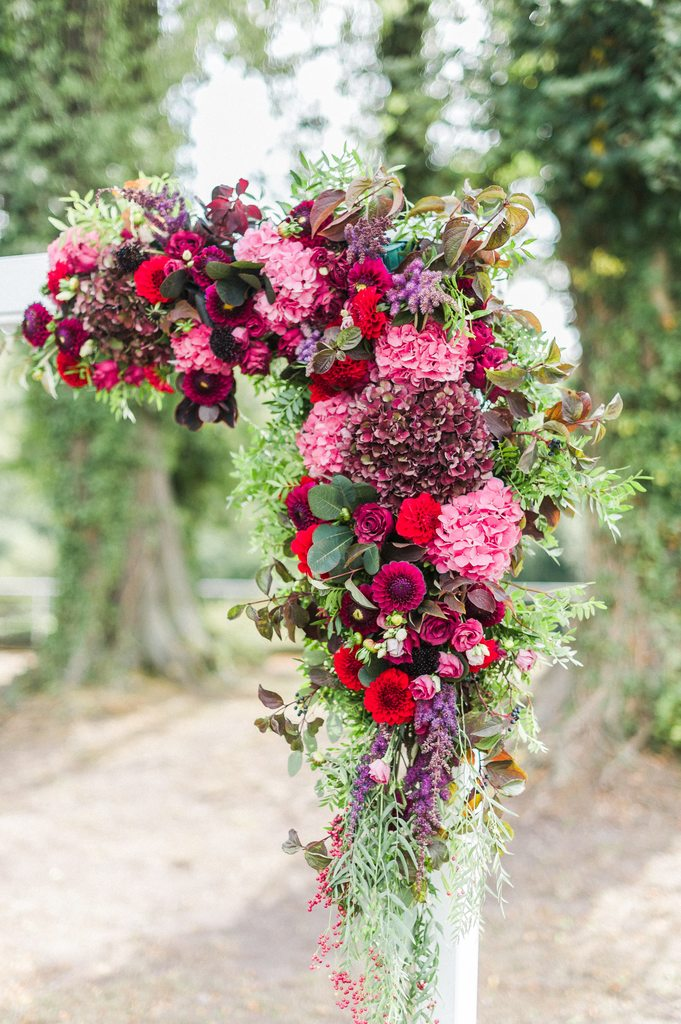 wedding ceremony, flower arch, burgundy flowers