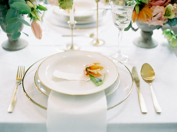 gold and white wedding tableware