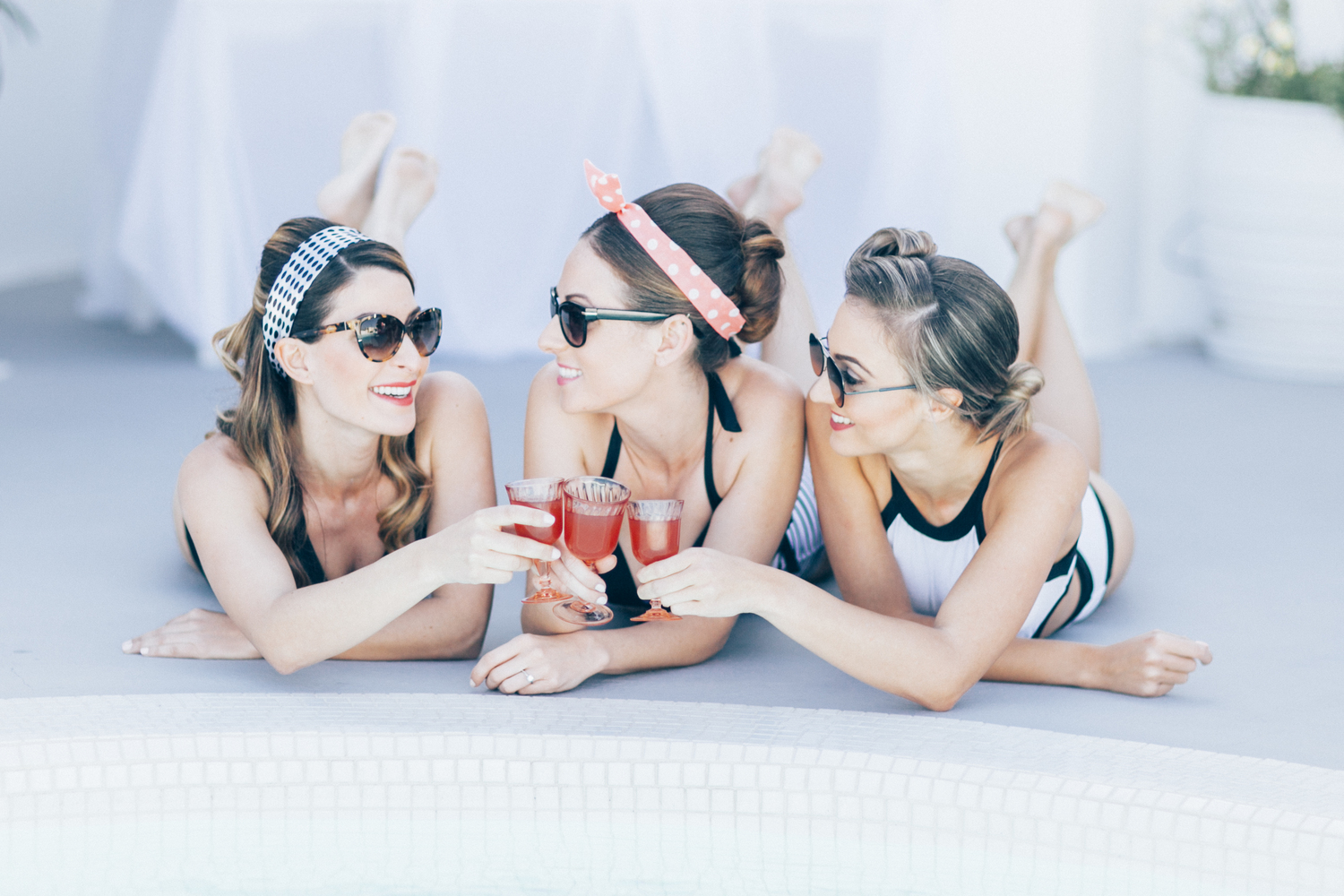 pool party, bride and her bridesmaids, cocktails