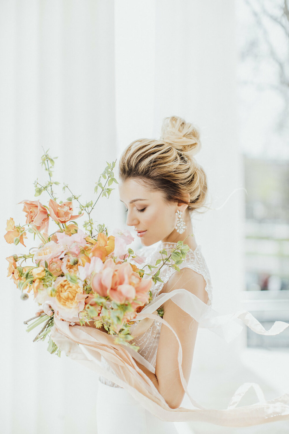 bride with a bridal bouquet, orange wedding flowers